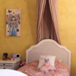 kids bedroom with gold theme