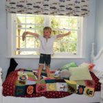 boy jumping on doffie designed bed