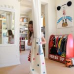 girl playing in playroom