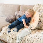 Boy playing on sofa with Doffie products