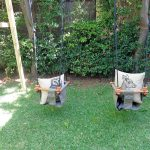 Outdoor play area with a swing set